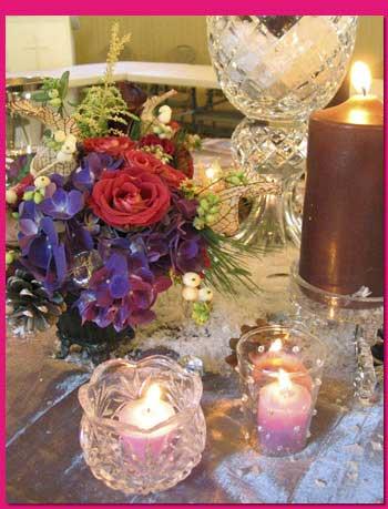 شمع آرایی(ترئین میز با شمع و گل)